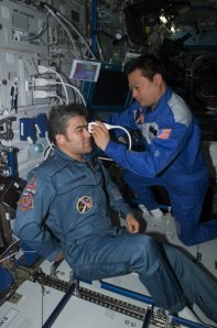 NASA eye test aboard the ISS. Photo courtesy of NASA